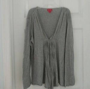 Think gray sweater. Pleats in front.